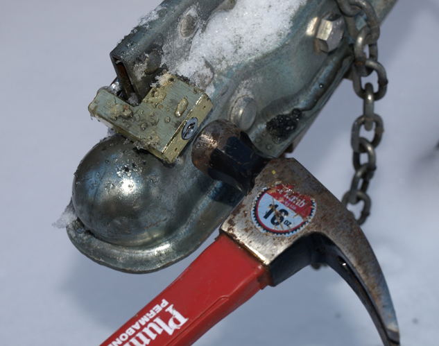 Snowmobile-Trailer-Security-Coupler-lock-being-hammered